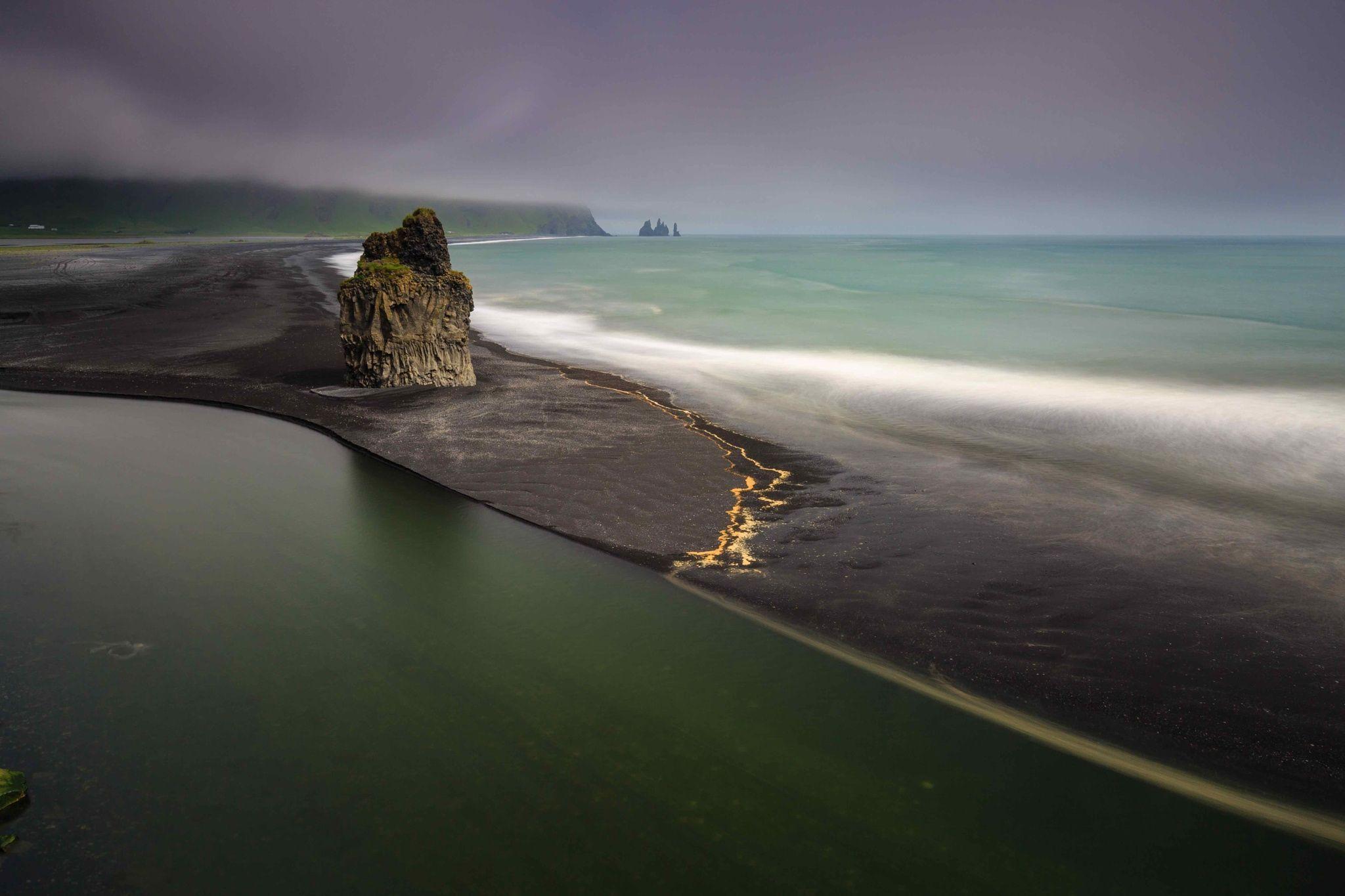ICELAND - Dyrhólaey Black Beach - A beach of black lava sand, along the eastern cost, at Dyrhólaey.