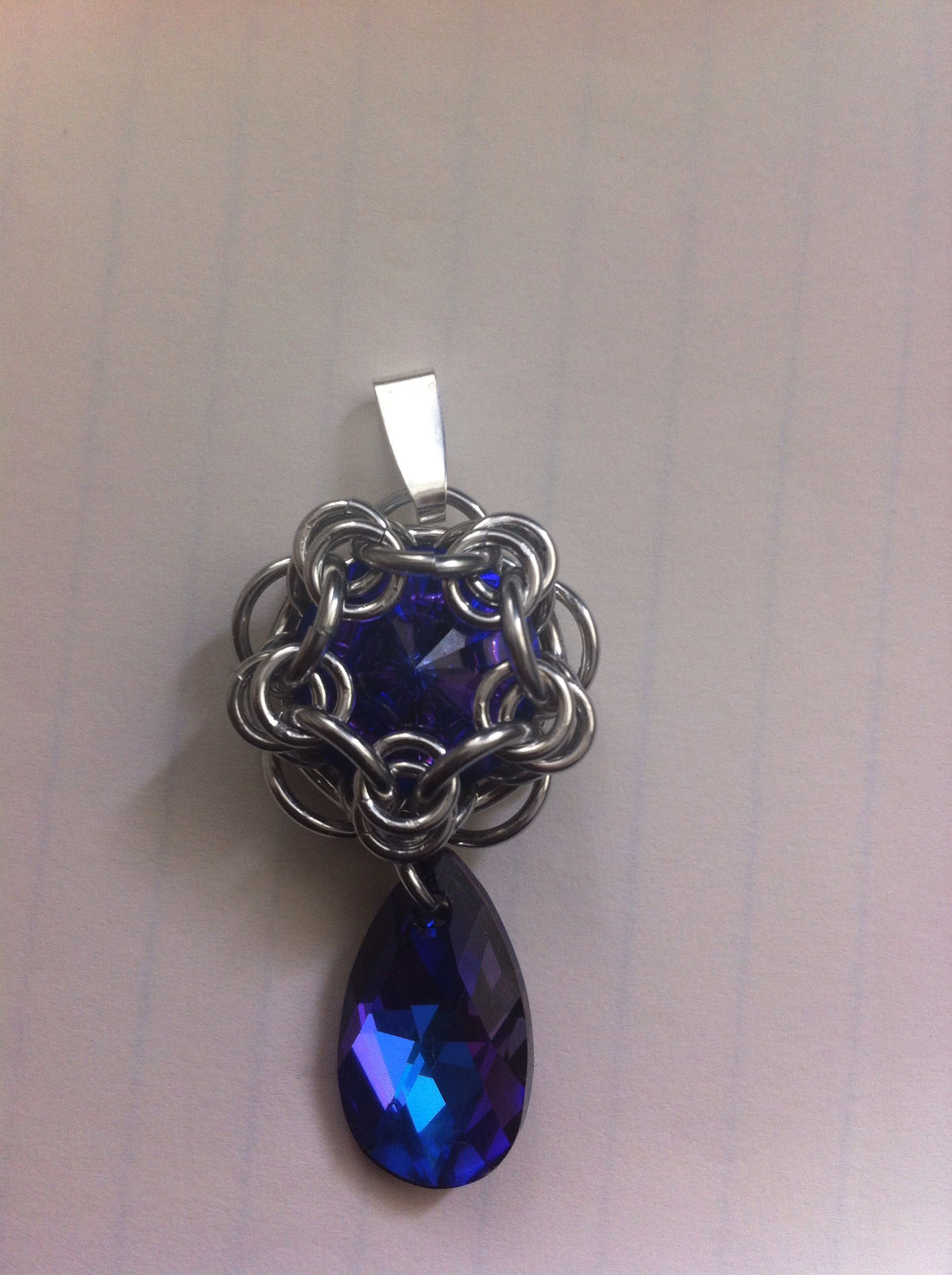 68846d9207a4b Heliotrope swarovski rivoli wrapped in chainmaille with matching ...