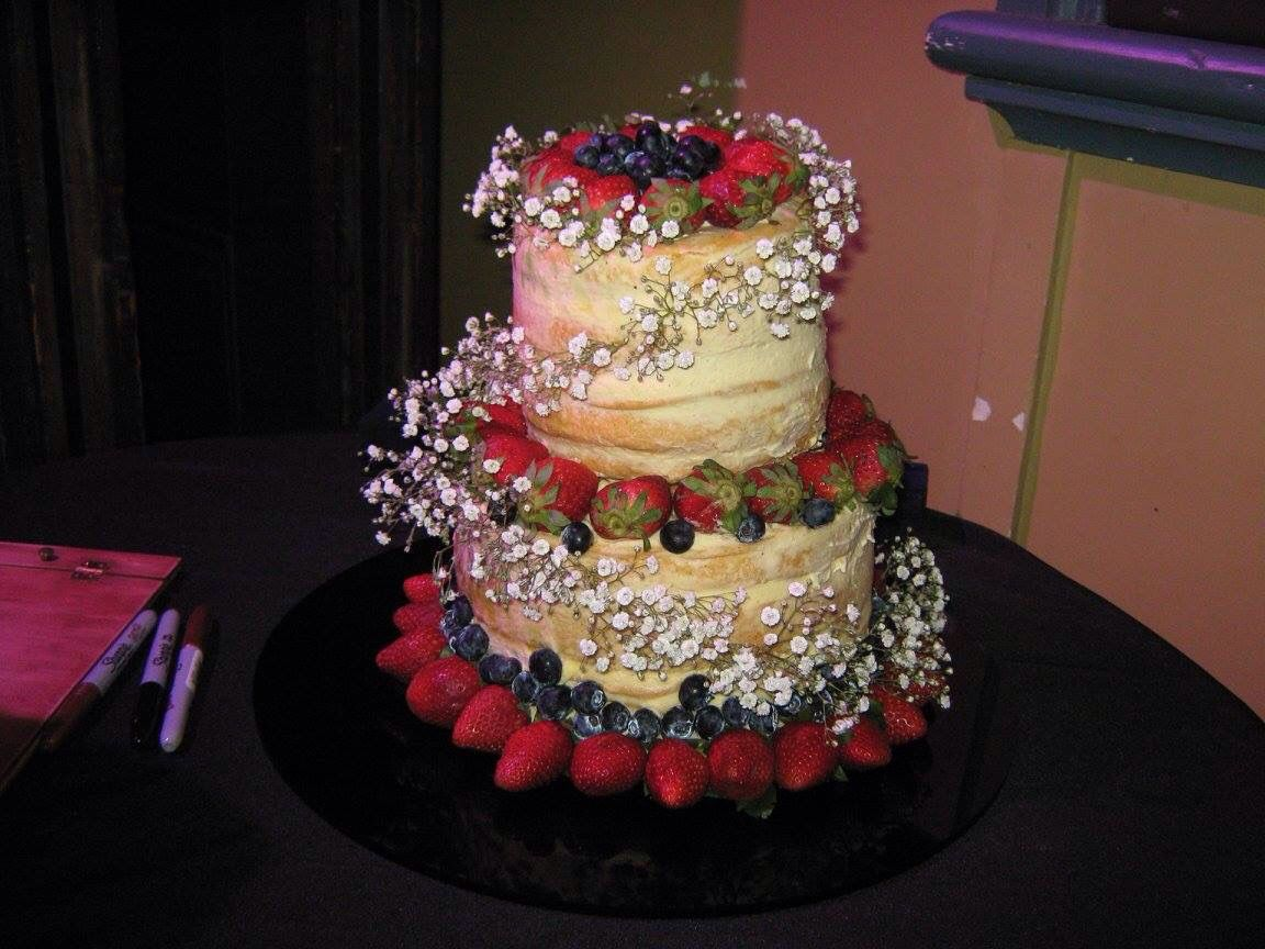 Naked Wedding Cake With Berries Vanilla Sponge Filled Passion Fruit Curd And Italian