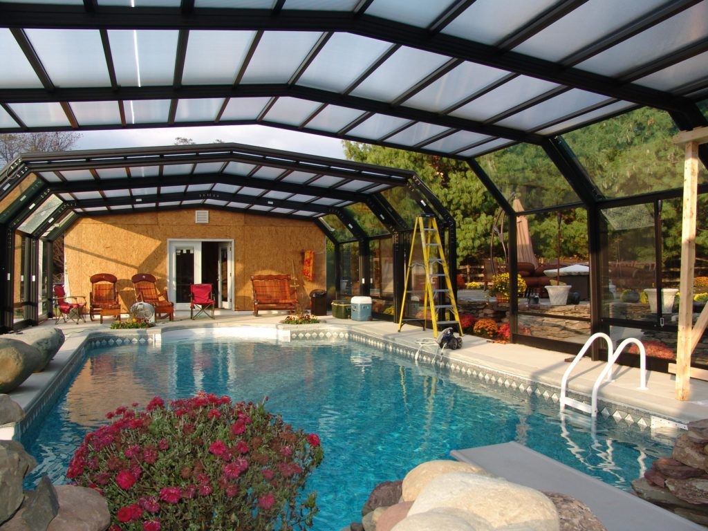 Retractable Pool Enclosures Manufactured By Roll A Cover Residential Pool Indoor Outdoor Pool Pool Enclosures