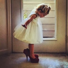 A picture of the flower girl in the brides shoes--I actually think it would  be cute to have a picture of my little sisters in my shoes instead  ) 6c819206470