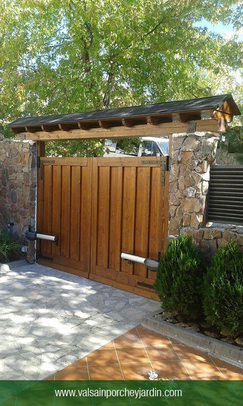 Puertas de garaje y marquesina en soto del real for Barandales de madera para jardin