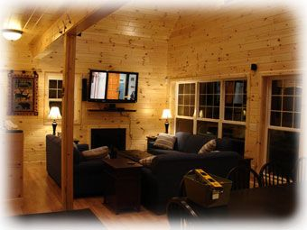 The Great Room features a 19-foot high ceiling, a dining table for 14 and cozy seating for eight in front of the gas fireplace and 50-inch Plasma TV & Home Theatre with DirectTV channel selection. It's a great indoor gathering place for the adults.