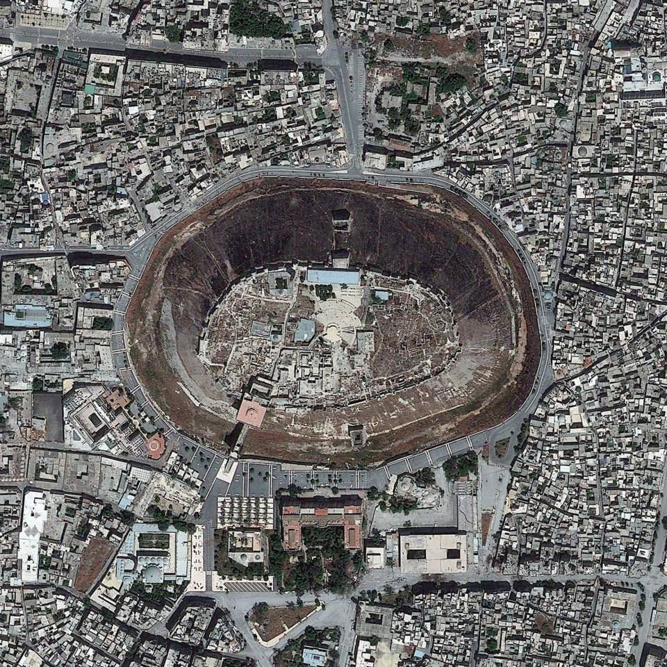 """The Citadel of Aleppo, a medieval fortified palace in Syria. If you rotate the picture 180 degrees, the """"hole"""" becomes a """"hill,"""" an interest..."""