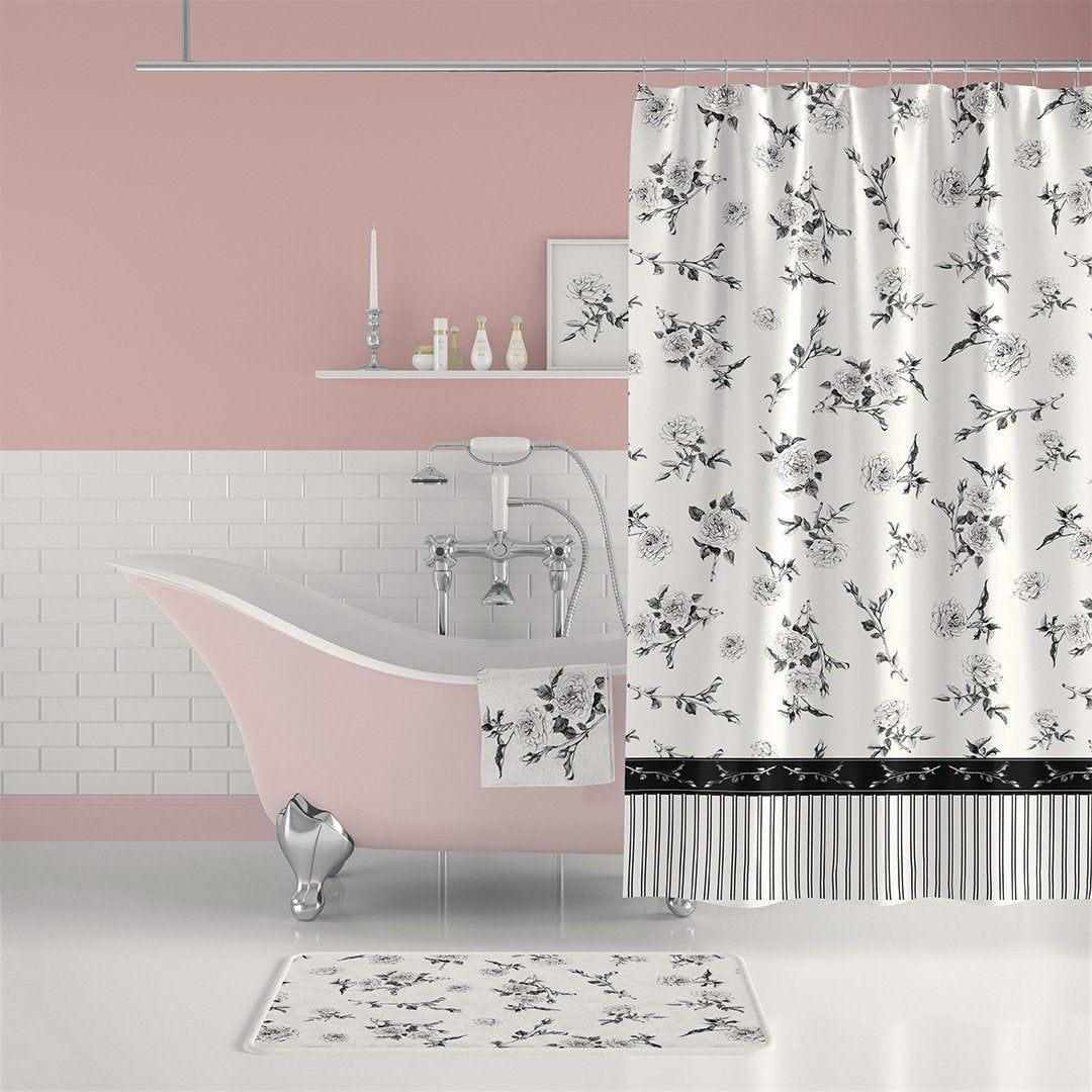 Black and white floral shower curtain with bath mat