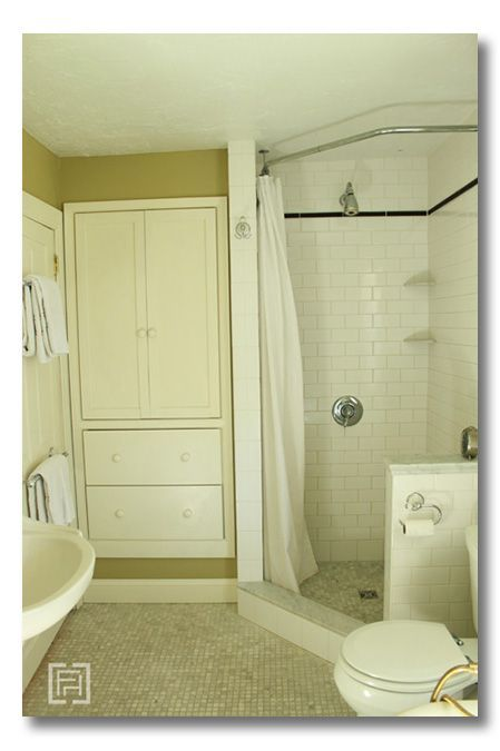 Love how this shower stall has been extended just a little to accommodate a curtain which can be easily replaced -- no more mildew on glass doors. Smart..