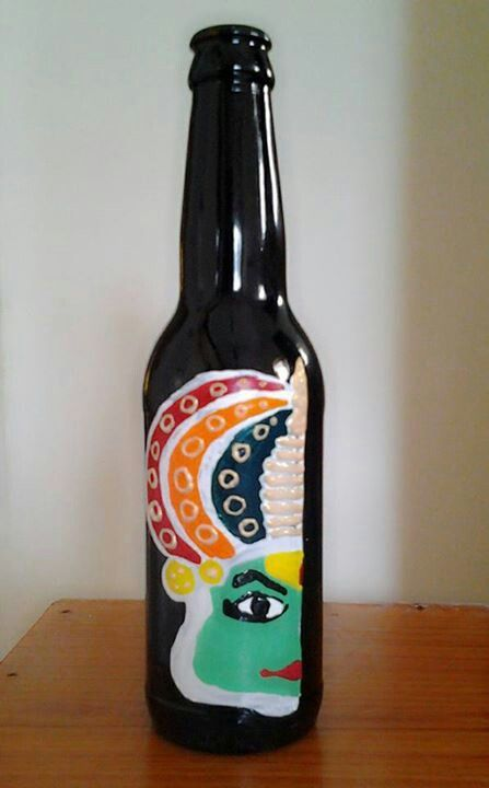 Kathakali face on bottle