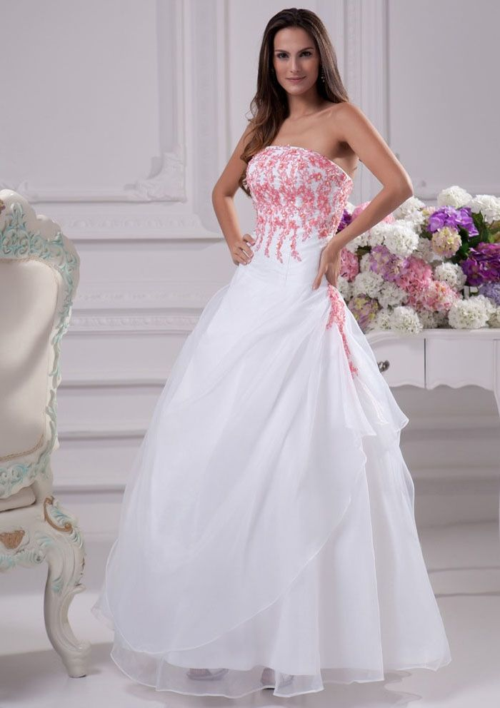 white wedding dress with pink accents