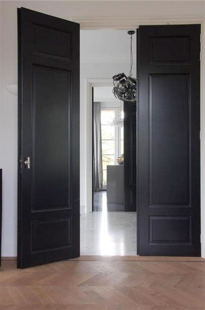Dark Grey Navy Black Painted Interior Doors With Lighter Paint On The Walls And White Trim