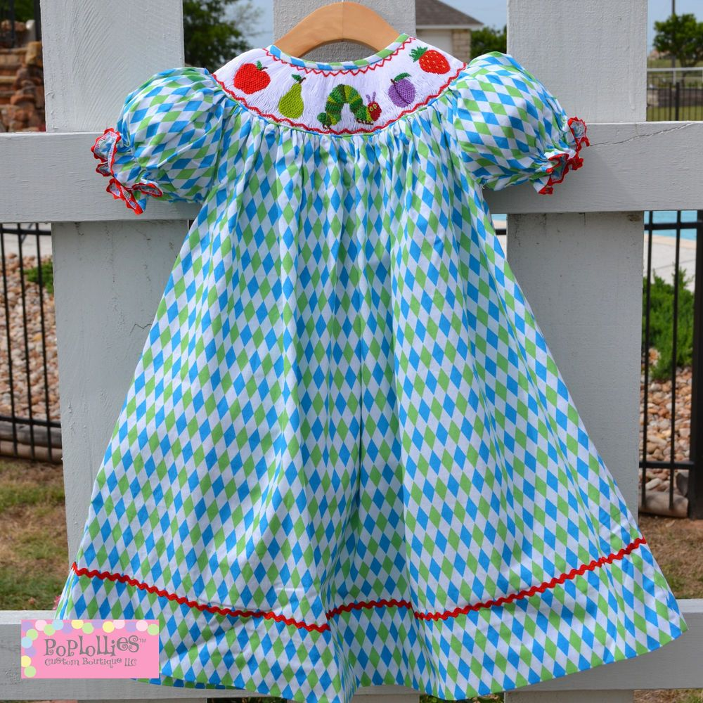 48587dd8bc13 NWT POPLOLLIES BOUTIQUE SMOCKED DRESS HUNGRY CATERPILLAR ON ARGYLE DRESS 12  MO