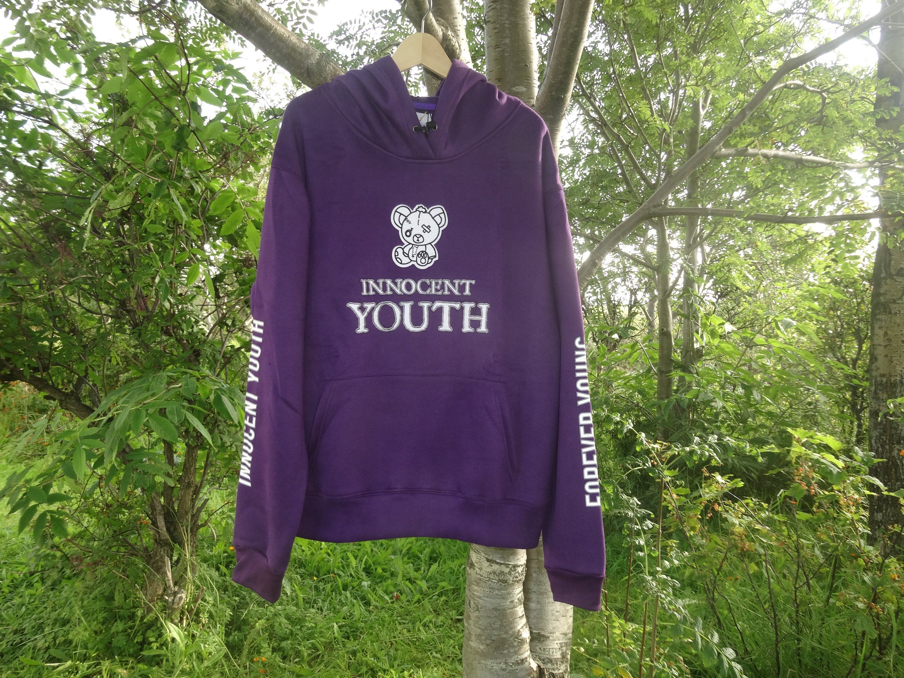 Unisex Innocent Youth Hoodie Is Represented With The Face Of A Etsy Purple Hoodie Hoodies Pullover Sweatshirt [ 2250 x 3000 Pixel ]
