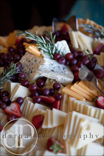 cheese board appetizer for cocktail hour-with an assortment of breads, dips, fruit and crackers.