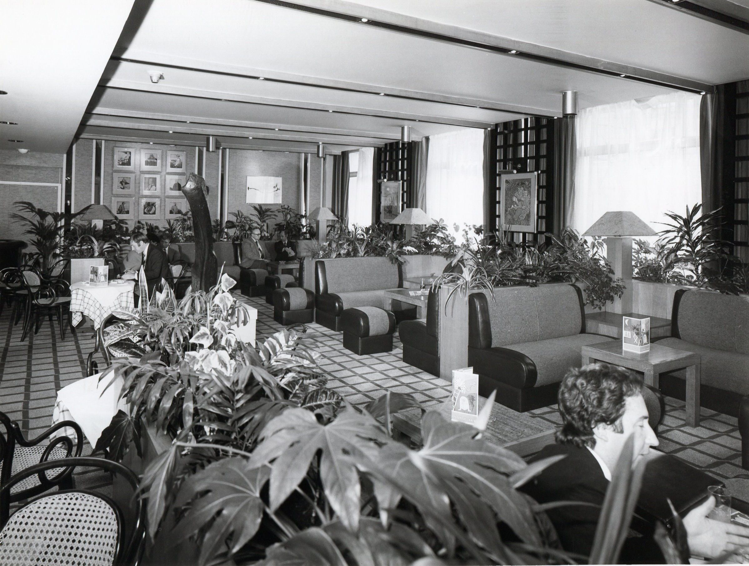 The current lounge certainly has less foliage