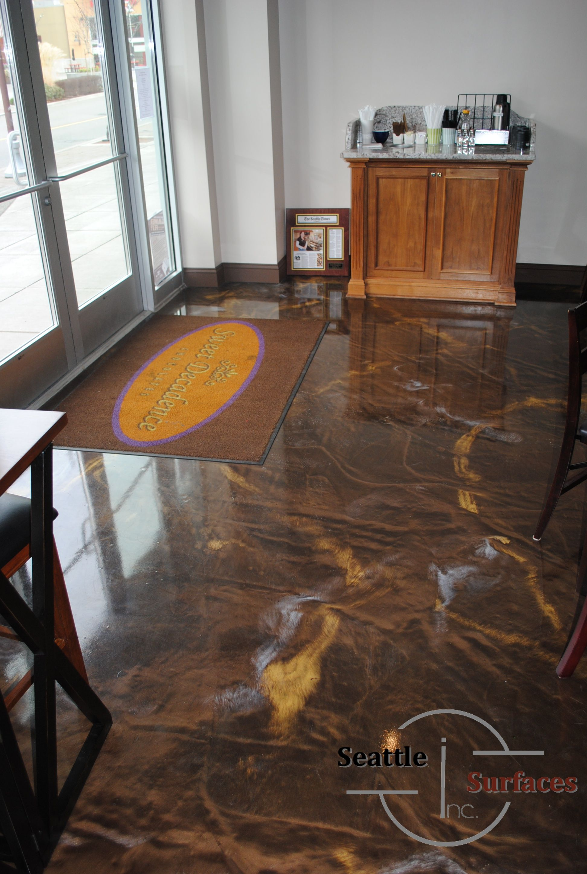 A designer metallic epoxy floor for a local chocolate shop and ...