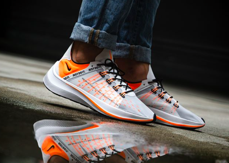 The Nike EXP-X14 Just Do It White Total Orange is featured in a lifestyle 829d729e6