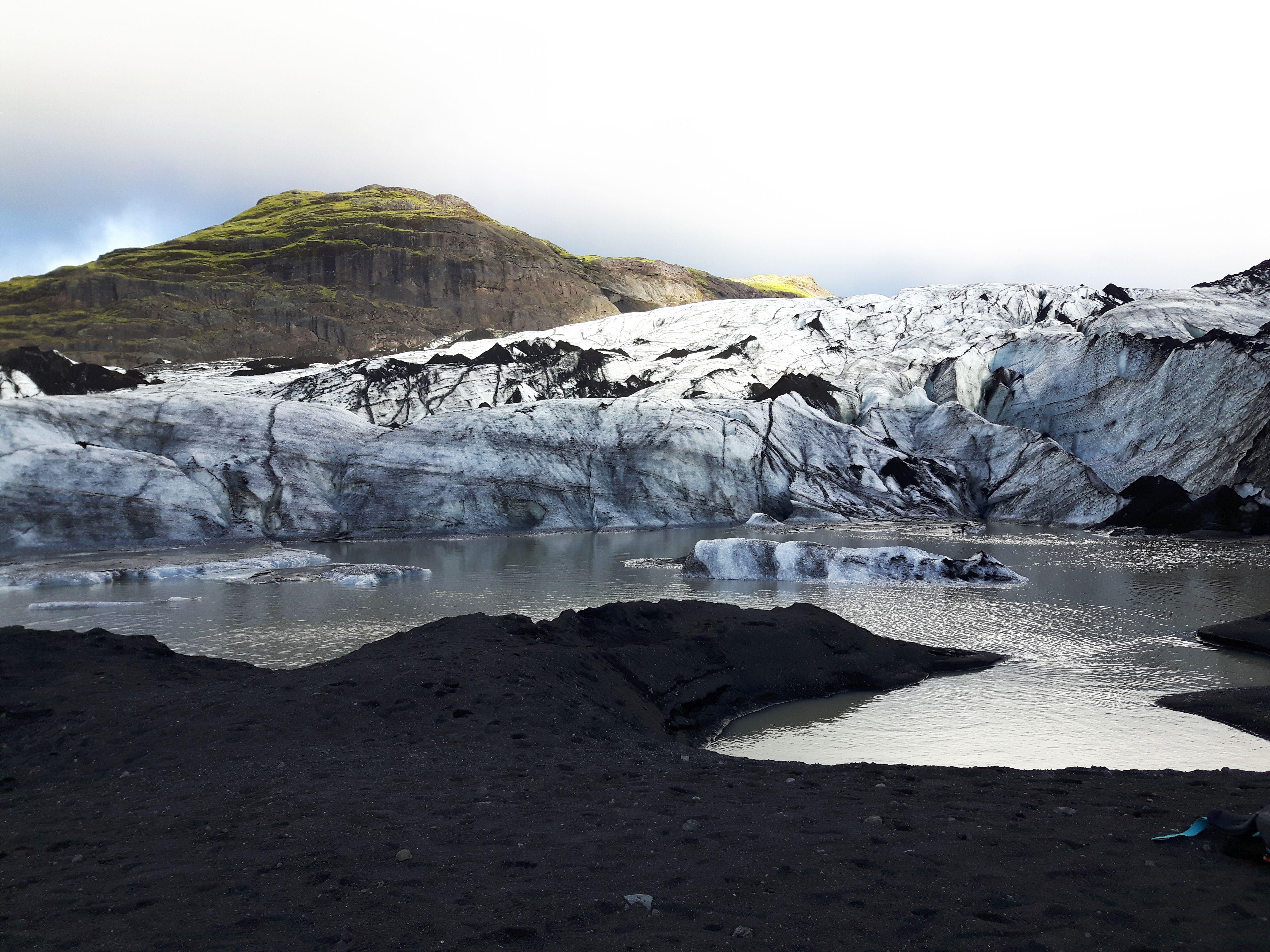 Hiking And Ice Wall Climbing On Solheimajokull Glacier