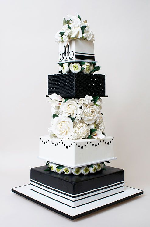 A black and white wedding cake is a classic option for a formal black-tiereception.