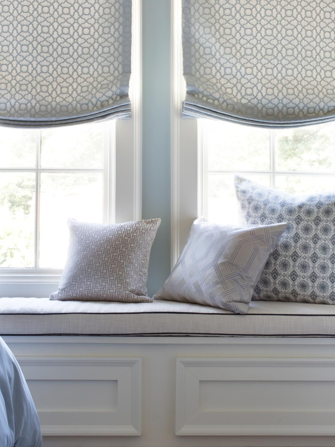 Outside window treatment ideas  what was considered dead space now serves as a comfy spot for guests
