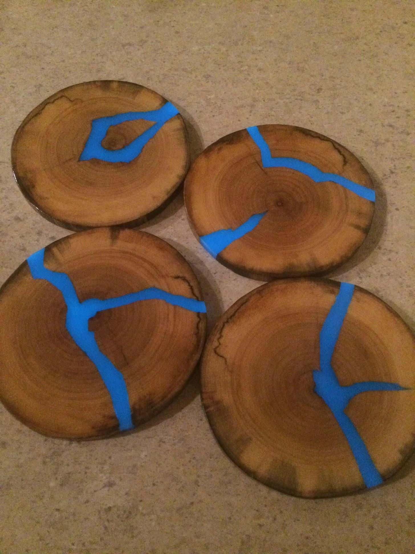 wood coasters with blue glowing resin inlays. Black Bedroom Furniture Sets. Home Design Ideas