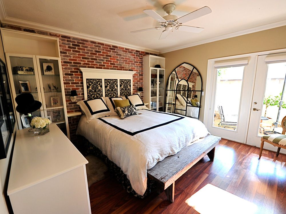 exposed brick wall and hardwood floors in bedroom - love ...
