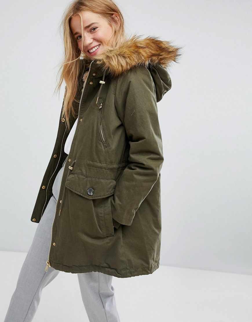 edbcd9cab173 Get this Pull Bear s fur coat now! Click for more details. Worldwide  shipping. Pull Bear Faux Fur Hood Parka Coat - Green  Parka by Pull Bear