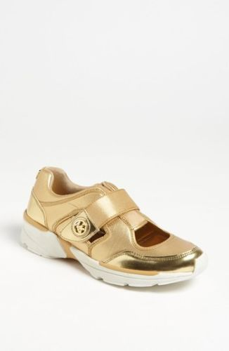 Michael Kors Walker Cut out sneaker. Gold color. Size 10. Good price. New in box
