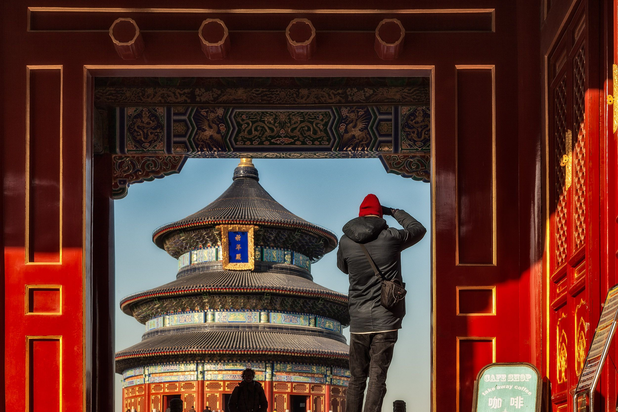 A tourist photograping in the grounds of the spectacular Temple Of Heaven in Beijing, China
