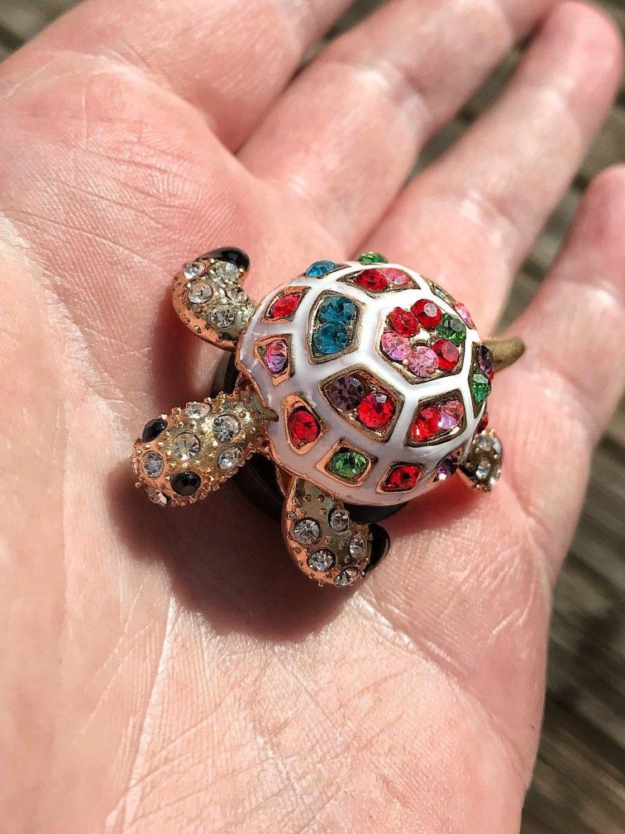 Super sparkly golden turtle with multi-colored rhinestones.