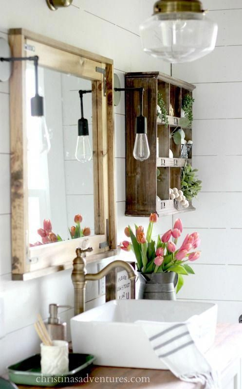 Photo of This vintage inspired farmhouse bathroom is filled with wood tones, mixed metals…