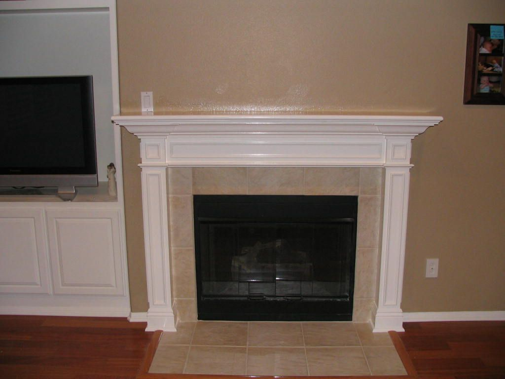 New fireplace design with white mantel and cream wall for Wood fireplace surround designs