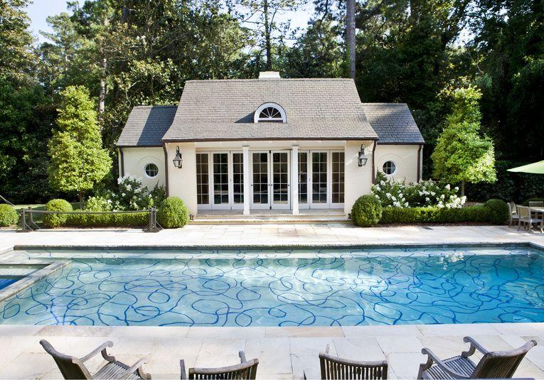 Outdoor pool with decorative bottom in Atlanta, GA designed by Tammy Connor Interior Design