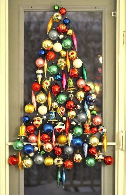 ornament tree made by hanging vintage ornaments within christmas tree shape on screen door no one has screen doors out here but if we did