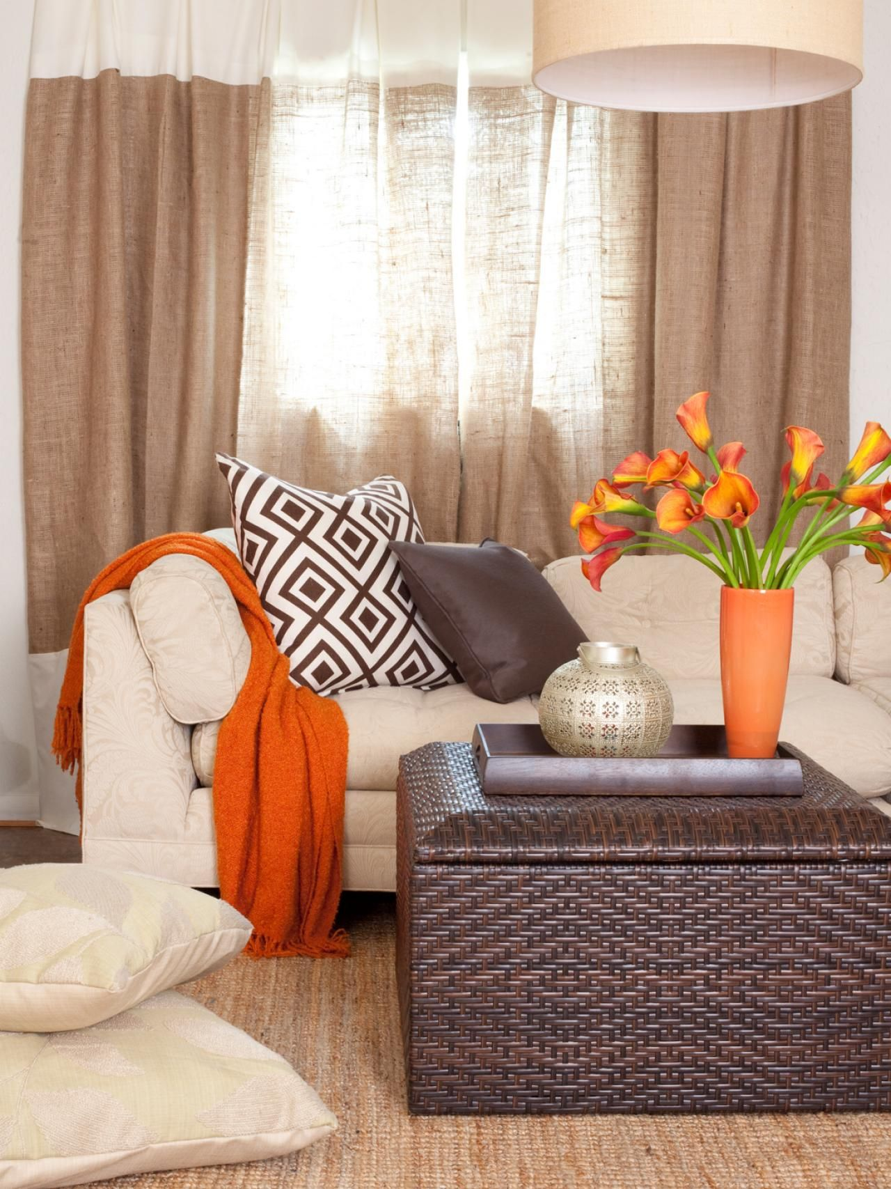 Calm, Earthy Attic Apartment  Living room orange, Brown living