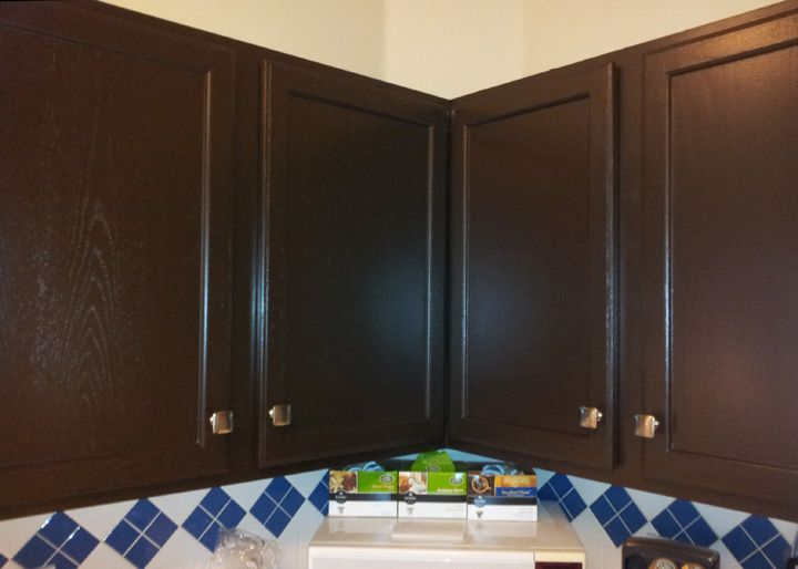 The dark color of these cabinets sherwin williams black - Colors that match with black ...
