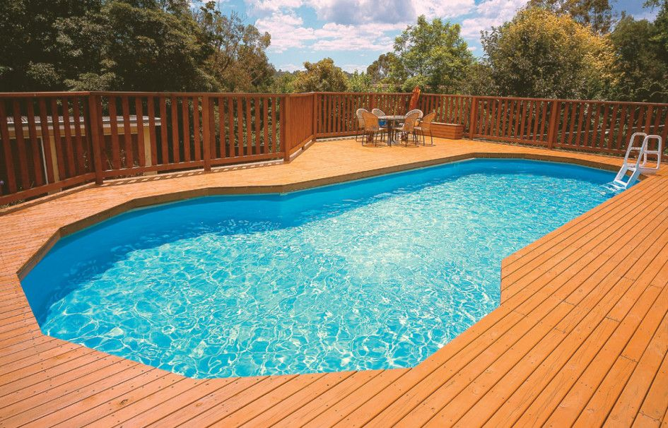 curve above ground pool with deck plus railing and pool ladder steps also