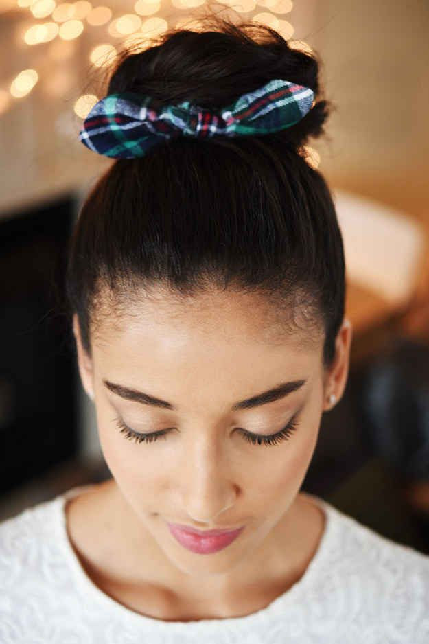 If you're always throwing your hair into a top knot, you can easily add a touch of ~class~ with this patterned scrunchie.