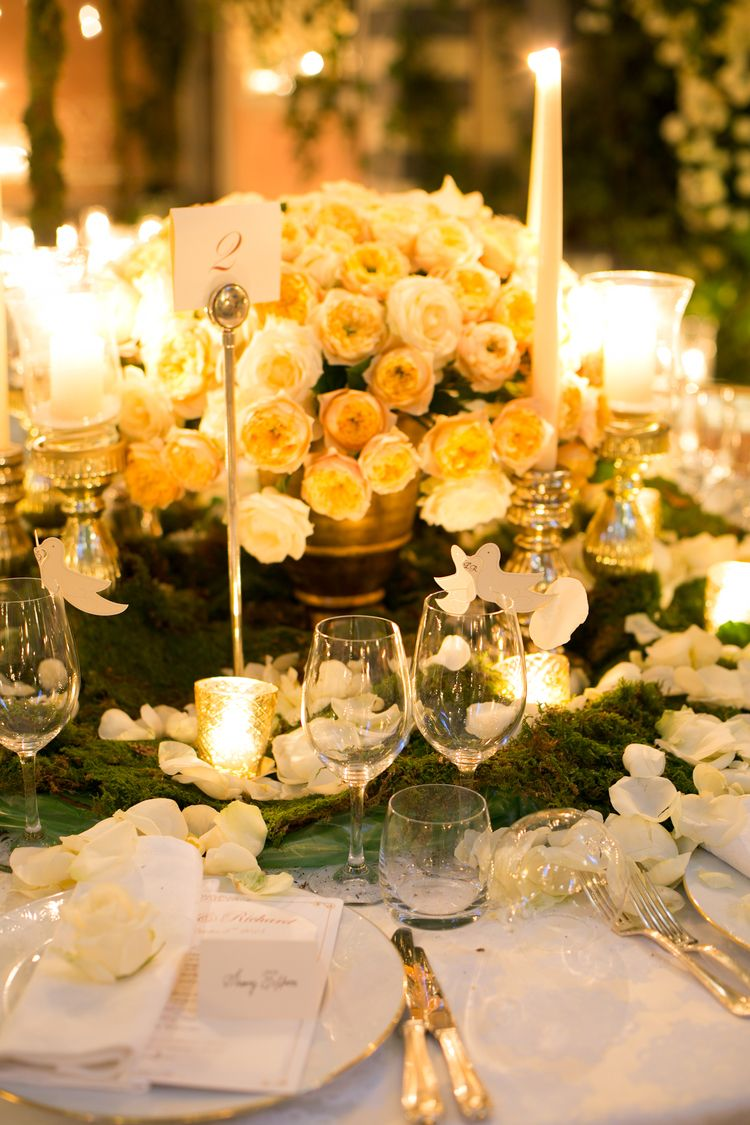 Low table flower decorations in gold vases