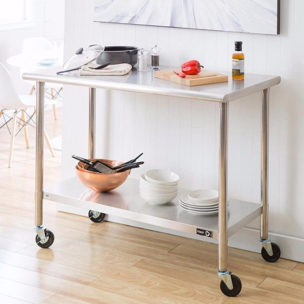 Portable in adjustable stainless steel table with wheels and