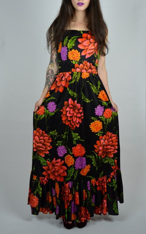 Incredible 1970s floral maxi! Done in a silky poly material. Bold floral pattern. Fitted bodice, center back zipper. Multi thin spaghetti