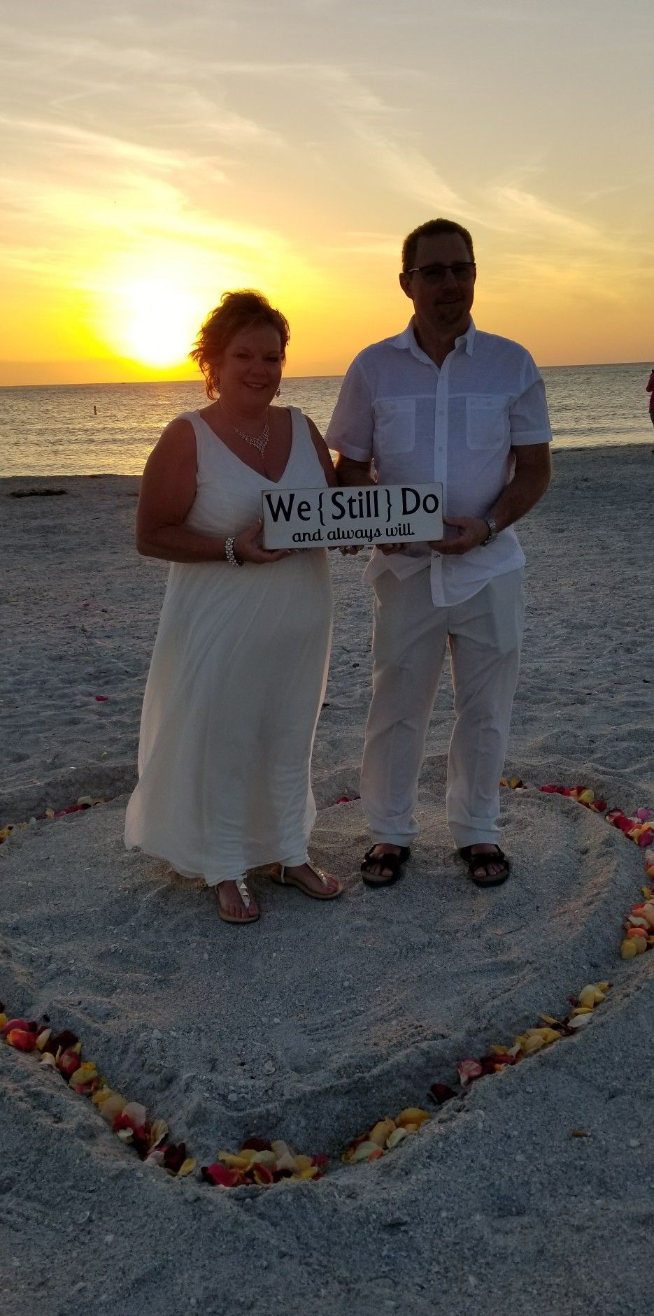 Sunset vow renewal ceremony. Romantic vow renewal ceremony