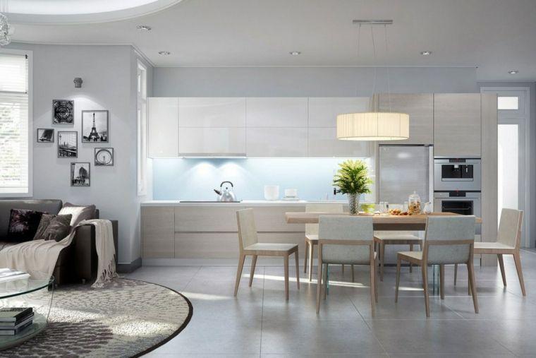 mobili chiari e moderni con cucina a vista, zona pranzo nel mezzo ...
