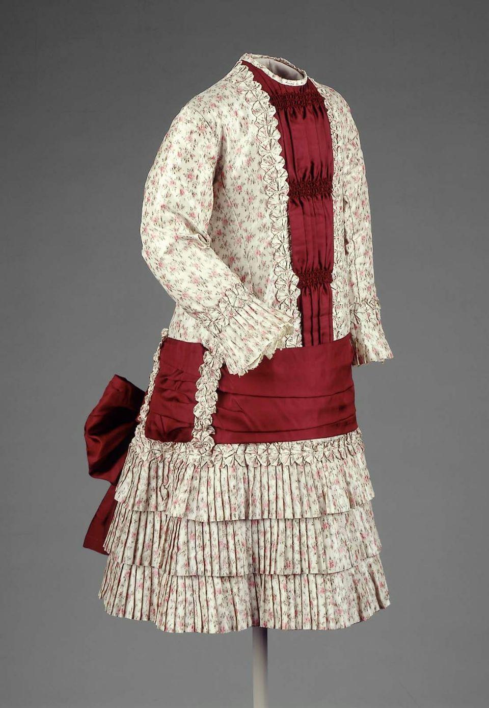Girl's dress, warp-printed silk taffeta and red silk twill with metal buttons, c. 1883, American.