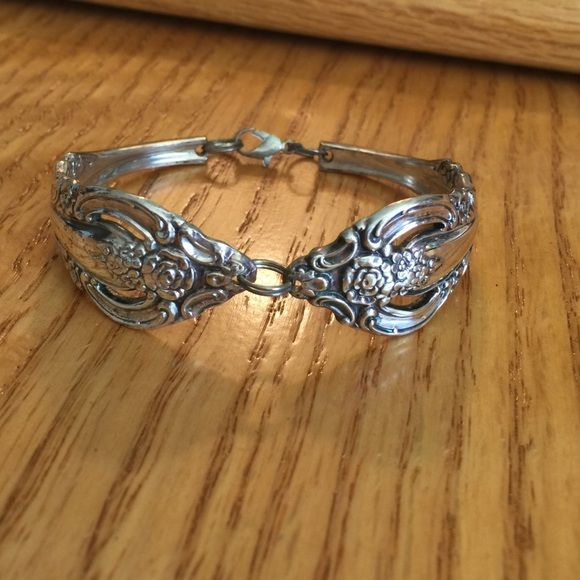 Sterling silverware bracelet. Made out of silverware.  Does tarnish as its silver but cleans very well Jewelry Bracelets