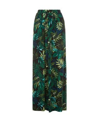 Just add a black camisole and platform sandals to this Dark Green Jersey Palm Tree Print Maxi Skirt for an evening look that's exotic and chic.
