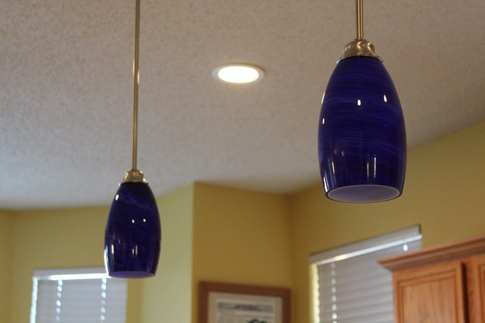 Kitchen these cobalt blue glass lampshades are perfect against the