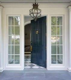 dark blue gloss front door with a white house and interesting ...
