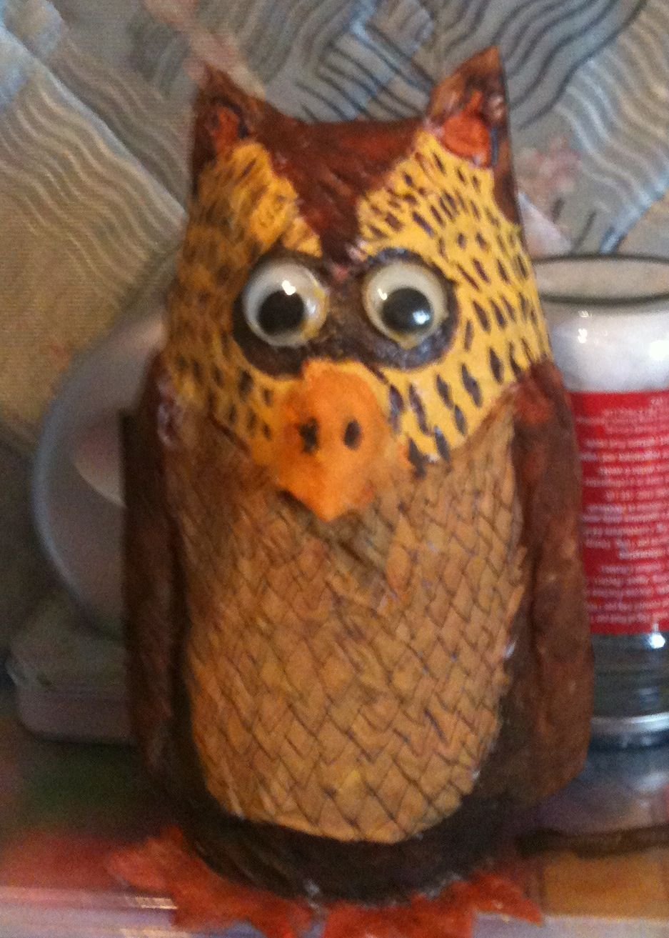 A paper machete owl I made using a jam jar as the main body to give him stability.