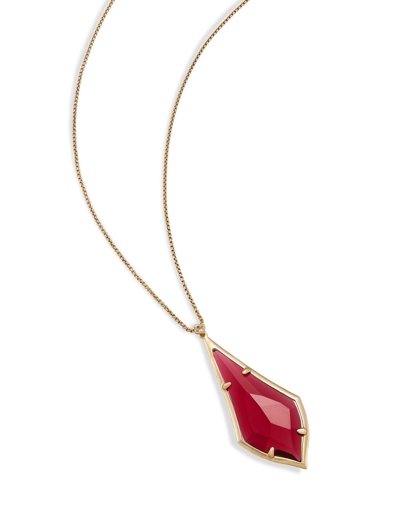 Shop brass long pendant necklaces at kendra scott with an elongated