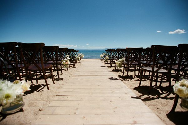 A must for sandy beach weddings.... wood plank isle runner.   Lake Tahoe Wedding with Bret Cole Photography