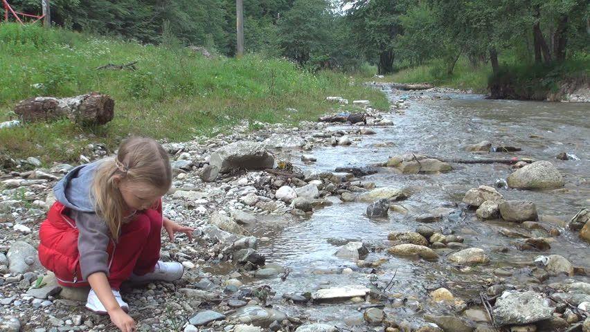 Child Playing At Mountain River Girl Throwing Stones In Stream Water Mountain River Kids Playing Fjallraven Kanken